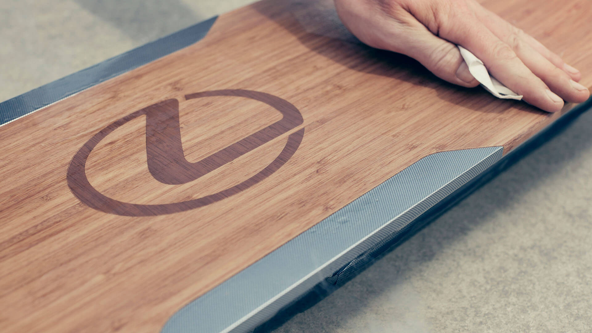 Someone cleaning a Lexus hoverboard